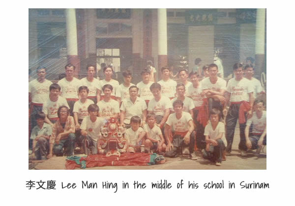 Lee Man Hing in the middle of his school in Surinam